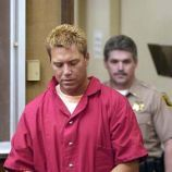 ** FOR USE AS DESIRED WITH YEAR-END PACKAGE - FILE ** Scott Peterson is led into Stanislaus County Superior Court in this Monday, April 21, 2003, file photo taken in Modesto, Calif. Peterson pleaded innocent to killing his pregnant wife, Laci, and their unborn son, Conner. (AP Photo/Ted Benson, Pool, File) FOR USE AS DESIRED WITH YEAR-END STORY. APRIL 21 2003 FILE PHOTO. POOL PHOTO