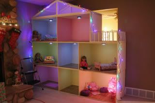 American Girl dollhouse lit up for Christmas, this is made in rows that stack on top of each other so you can move it