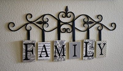 A Diamond in the Stuff: Family Hanging Plaques. have this kind of wrought iron thing and can add family letters to it.