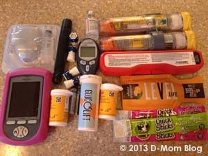 Here are all of the diabetes supplies we can fit into the Myabetic Love Bug bag.    Giveaway of this or a sports-themed bag. Ends 2/5/13.