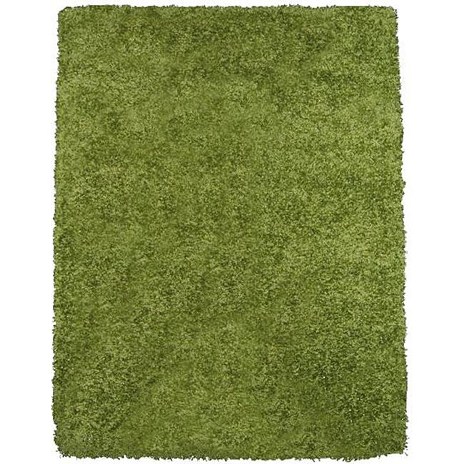 Complete the look of your home with this touchably soft green shag rug. The shag rug is featured in a casual style and in a deep dynamic color.