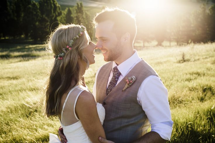 bride and groom at sunset in grassy field on hill in country NSW, bride wears flower crown by Lilygrace flowers