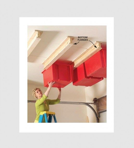 clever household tips - plastic storage bins on ceiling tracks
