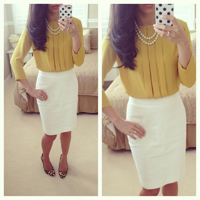 Cream pencil skirt and mustard blouse topped off with a classic set of pearls.