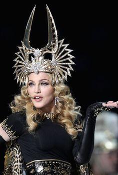Madonna wears a Philip Treacy headgear