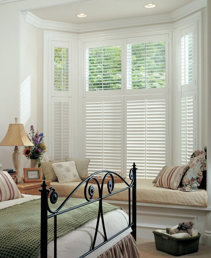 Two tier white wood Shutters blend perfectly in this period home with classic windows, #luxaflex #shutters #home decor #white