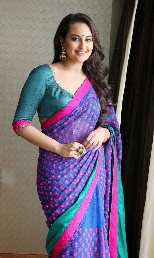 Desi girl Sonakshi Sinha took our breath away in this brightly hued sari. #Bollywood #Fashion #Style #Beauty
