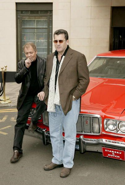 Actors David Soul and Paul Michael Glaser attend a photocall ahead of the UK premiere of the movie remake of US TV series 'Starsky And Hutch' at The...