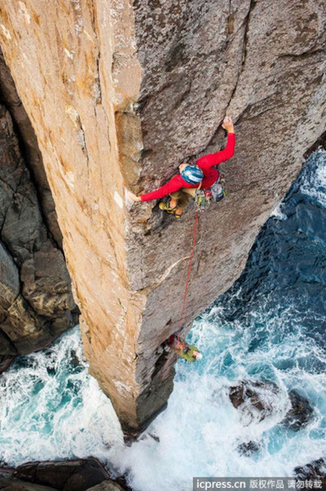 Daredevil climbers tackle the Totem Pole at Cape Hauy. #rockclimbing #tasmania #discovertasmania #capehuay Image Credit: Simon Carter