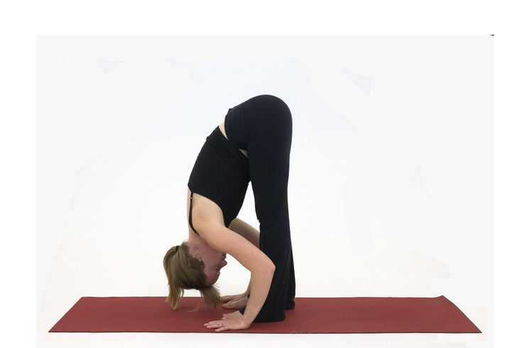 20 Ways to Stretch Your Hamstrings With Yoga: Standing Forward Bend – Uttanasana