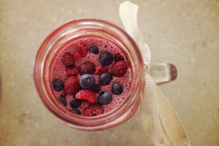 A blueberry and raspberry smoothie in a vintage pink jar <3