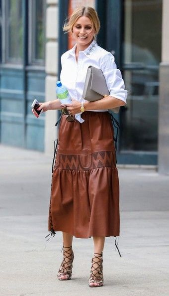 Socialite Olivia Palermo spotted out and about in New York City, New York on August 4, 2014. Olivia was rocking her new blonde hair-do and it went good with the white shirt and brown leather skirt she was wearing. #prom #heels