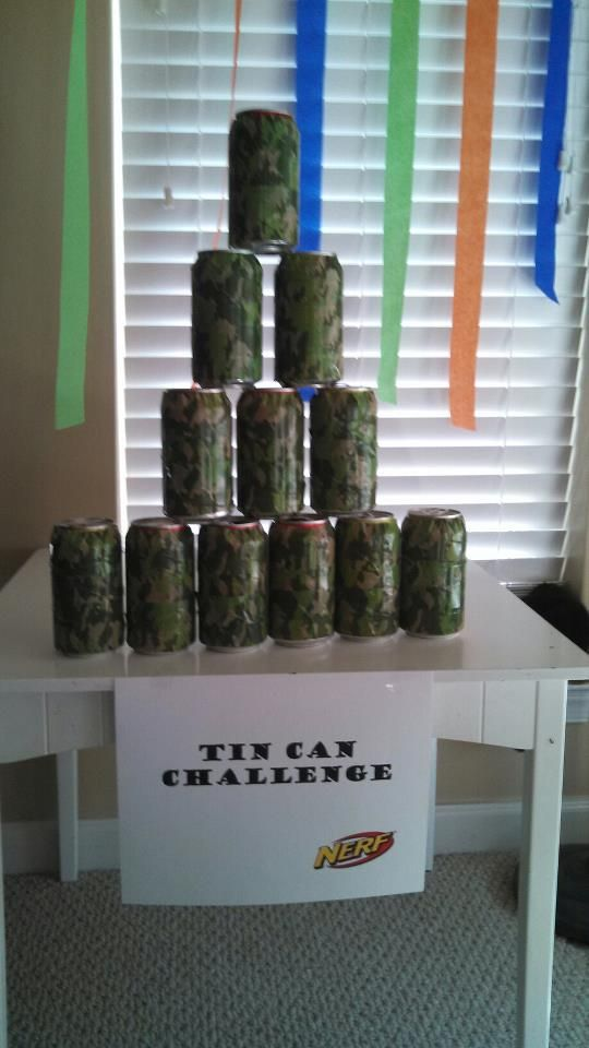Nerf Gun Party Ideas Soda cans covered with camouflage tape. Perfect for shooting range targets!
