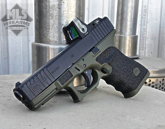 Glock 23 gen 3. Graphite black and OD Green Cerakote, milled front serrations, med texture stippling, double undercut trigger guard, beveled mag release and deep index points done in house, RMR cut by @jager_werks #Glock #G23 #stippling #Machining #Cerakote #mlsfirearms