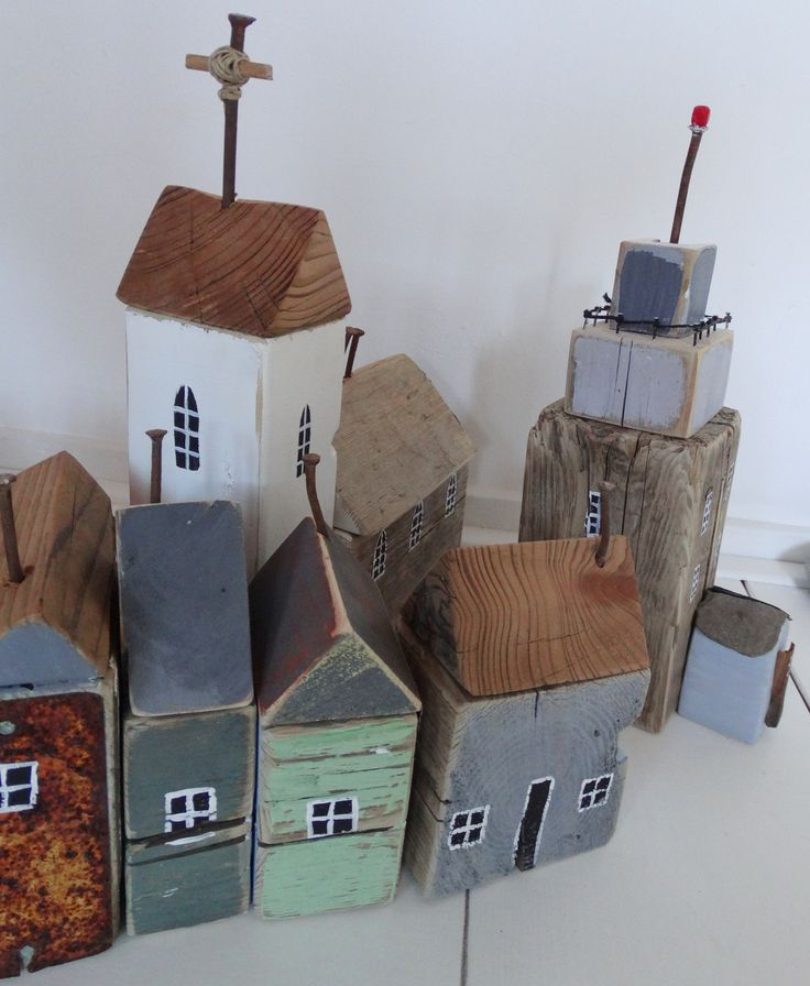 Cute! Doesn't quite do this Little Houses Town justice, great use of drift Wood, old nails, string & wire etc. ;)