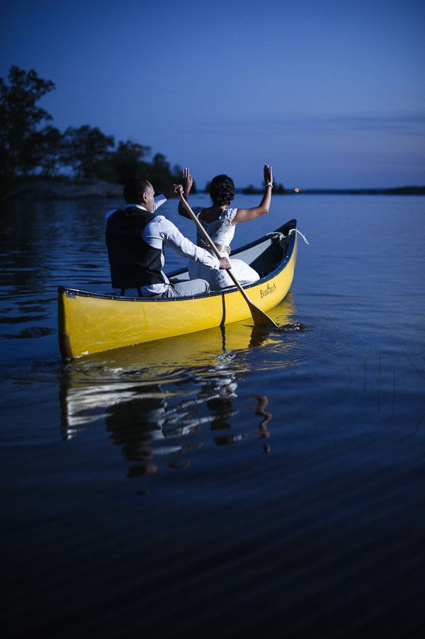 Exit the reception by canoe to have a few special moments alone post wedding