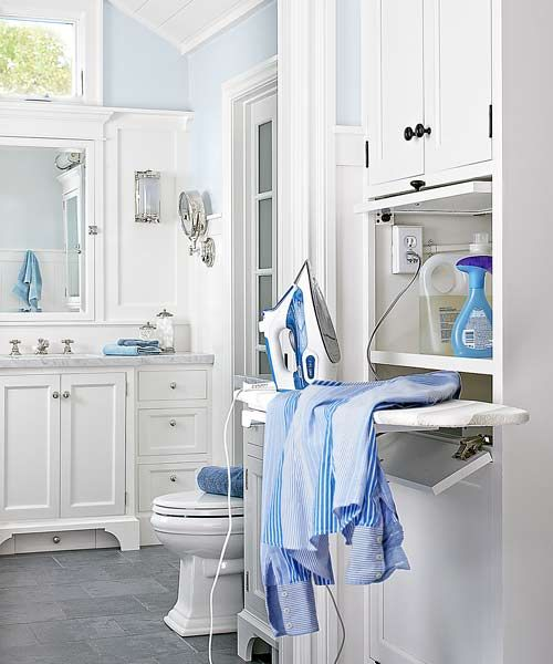 bath and laundry after remodel tall cabinets with pop-out ironing board with radiant heat mat