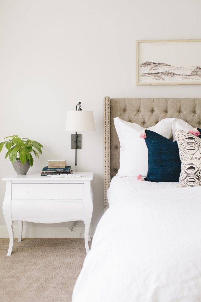 neutral master bedroom inspiration with tufted upholstered bed love these swinging arm wall sconces