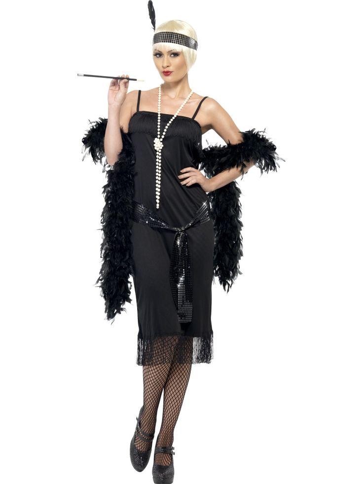 Déguisement charleston femme : Ce déguisement de charleston pour femme se compose d'une robe, d'une ceinture ainsi que d'un bandeau avec plume (Bas et chaussures et boa non-incluses).Ce déguisement...
