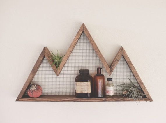 Decorate and utilize your wall space with these unique and eye catching mountain shelves. Made from 100% American Grown Hemlock, these rustic wall ornaments are sure to add an outdoorsy feel to any room. These wall shelves are available in a walnut finish.  Product details:  Featured in Walnut Dimensions- 25 x 14 x 2.75  Wood Type- American Grown Hemlock  All of our products are made by hand in our northwest work shop and we faithfully stand behind their quality.