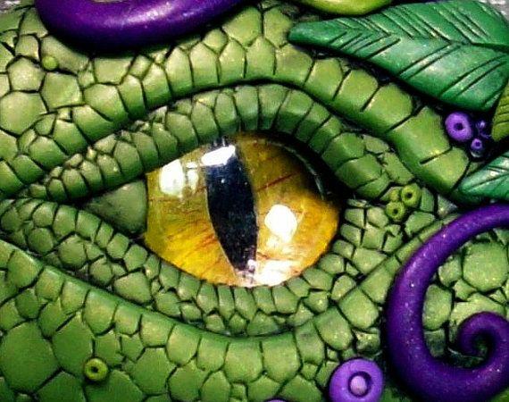 Woodland Dragon Eye Cabochon w/Purple Accents via Etsy.  Made of polymer clay by artist Chris Kapono.