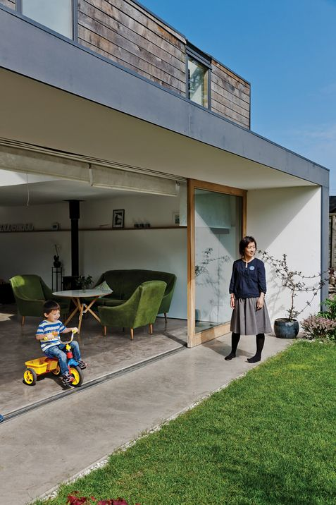 Why shouldn't Kai be able to ride his tricycle from the living room directly outdoors? Love the furniture too:)