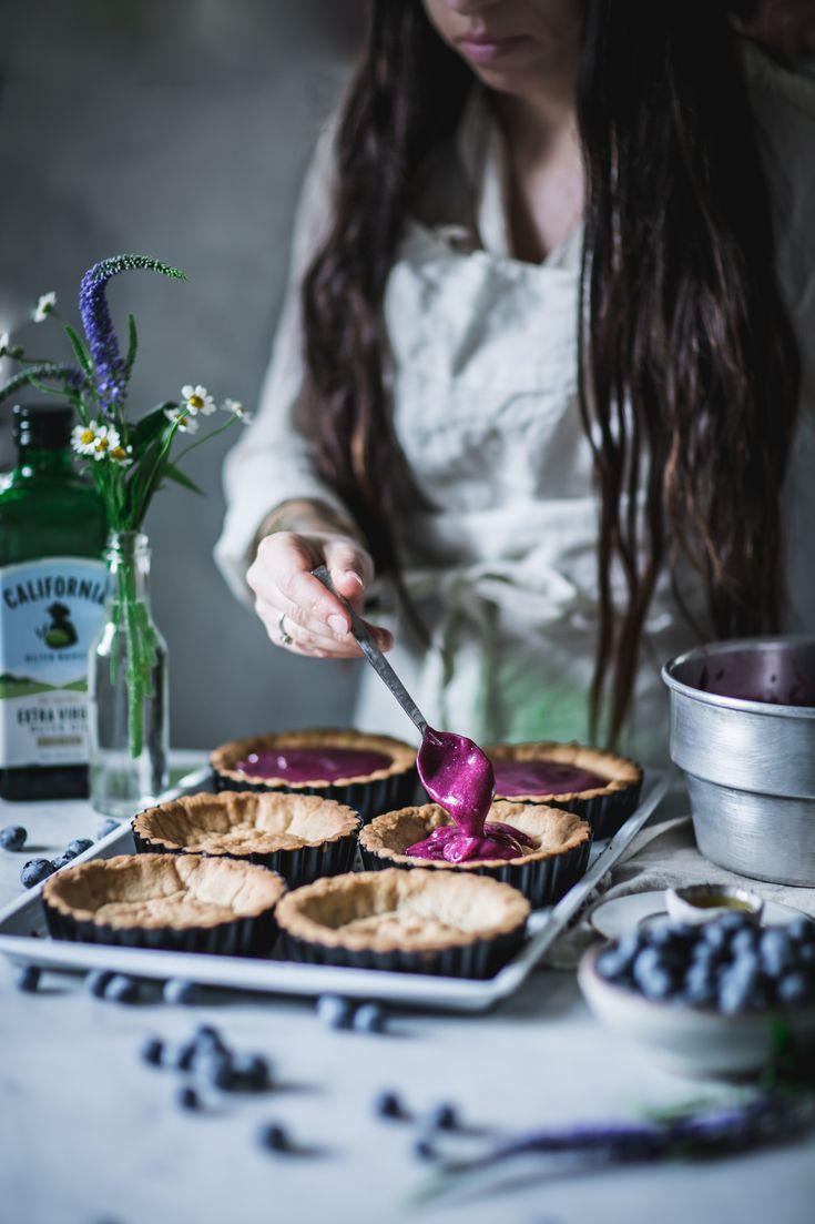 Blueberry Lemon Olive Oil Curd Tartlettes http://adventuresincooking.com/2017/04/blueberry-lemon-olive-oil-curd-tartlettes.html