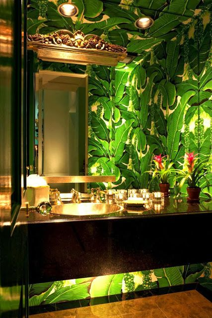 High drama is perfect in a powder room. Note under cabinet lighting. Brazilliance - The Glam Pad