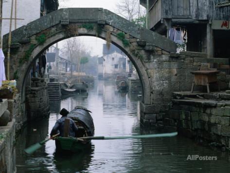 A Bamboo Boat Makes Its Way Through Shaoxing Water Town, Shaoxing, Zhejiang, China Photographic Print by Keren Su at AllPosters.com