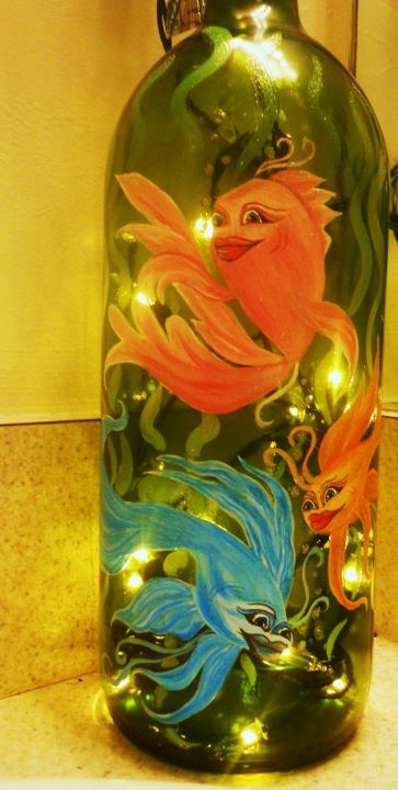 Painted wine bottle with lights inside -- cool decoration idea, if you've got the talent!!     (I don't...)