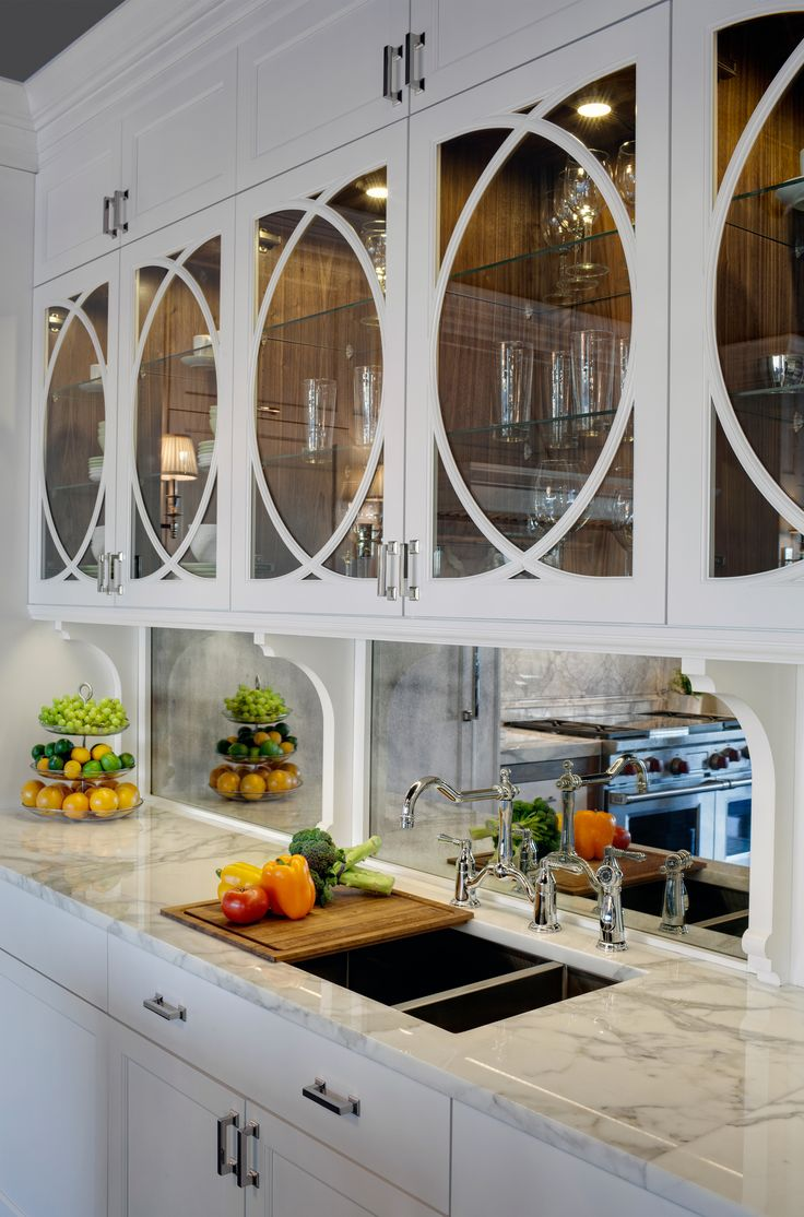 20 best lincolnwood showroom images on pinterest dream kitchens love those cabnit dooors kitchens white kitchen cabinets marble countertops polished nickel bridge faucet antique mirrored backsplash gorgeous kitchen