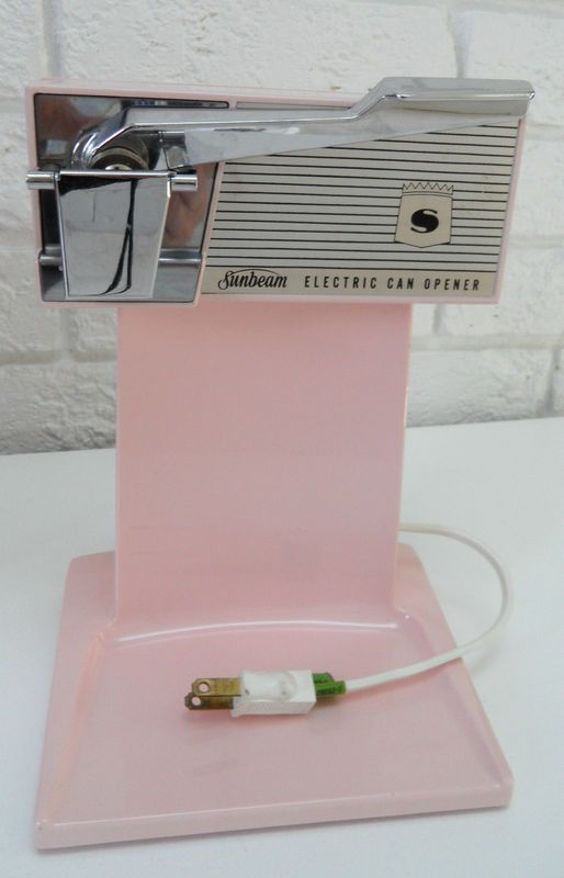 STILL IN THE BOX 1950s pink electric Sunbeam can opener. (I had this in turquoise... haven't seen it since we moved. Huh.) This  is on eBay right now. It has already been bid up to over eighty bucks with two days left. But if you take your pink MCM seriously, you may want to get on this!