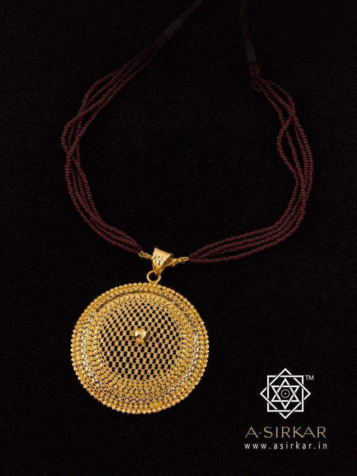 Jhuri Pendant: An evocative pendant that references the local craft of basket-weaving using another, but totally different, local craft of gold working, becomes a wonderful expression of a humble item of utility transforming into a splendid example of the decorative arts -- an intricate, filigree-katai Jhuri made in 22K gold and worked, top to bottom , by hand.   Sometimes, it's the commonest everyday things that inspire most.