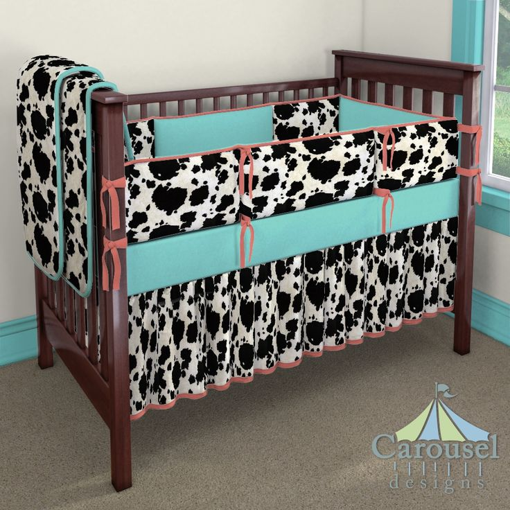 Crib bedding in Black Cow Suede, Solid Coral, Solid Teal. Created using the Nursery Designer® by Carousel Designs where you mix and match from hundreds of fabrics to create your own unique baby bedding. #carouseldesigns