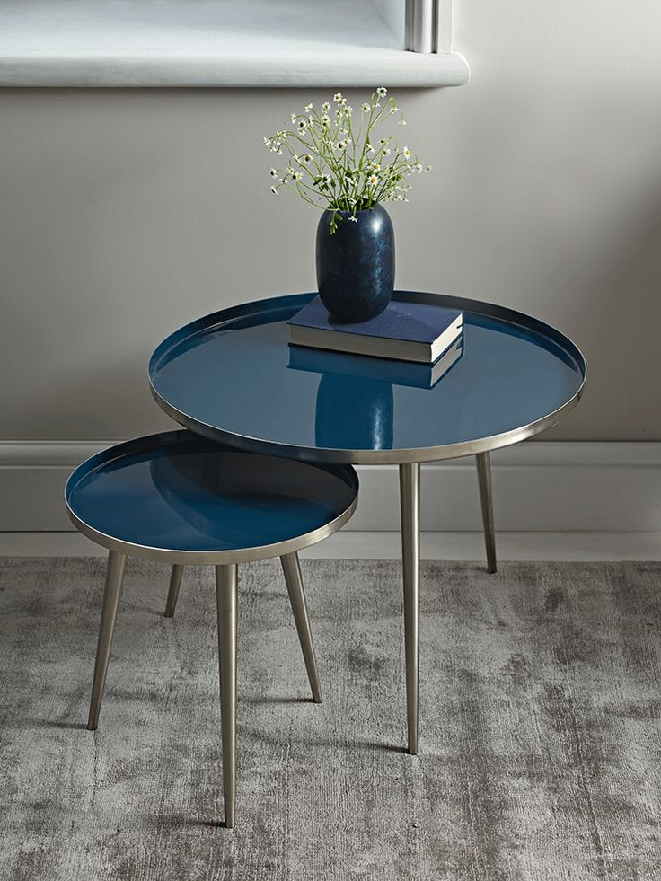 Crafted from sturdy powder coated iron with a deep blue, glossy enamel top, our unique side tables will make a Scandi inspired statement in your living space. The perfect occasional surface for your home, their slender, nickel legs create an elegant silhouette.