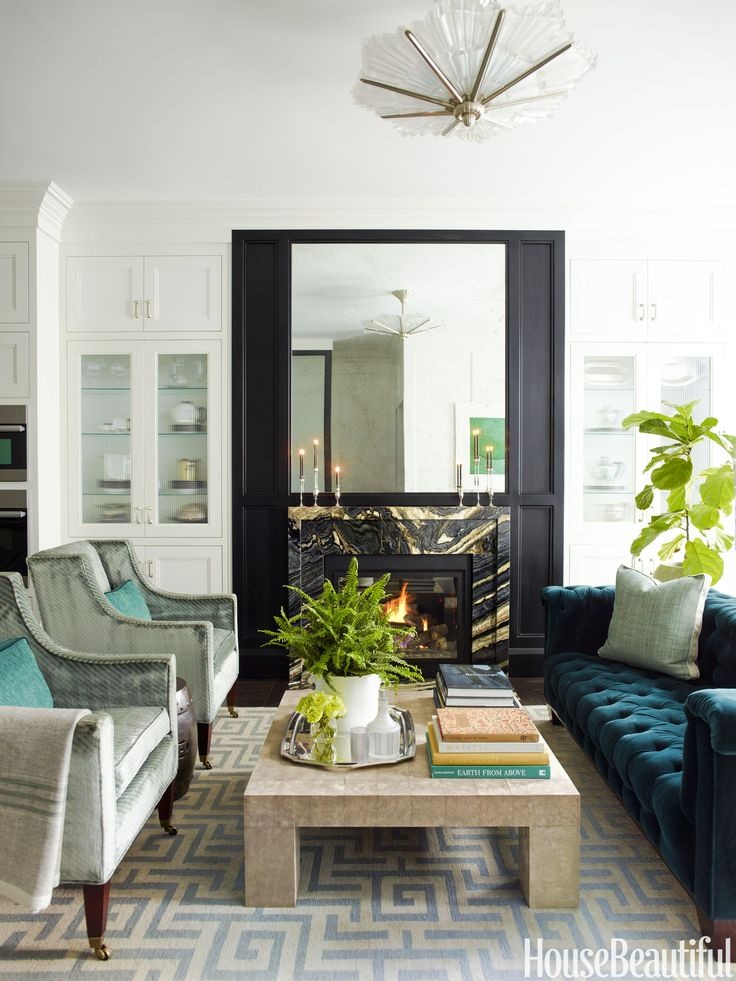 """In this renovated Federal Revival rowhouse in Boston's Beacon Hill neighborhood, """"the living room is an extension of the kitchen,"""" says Nina Farmer."""