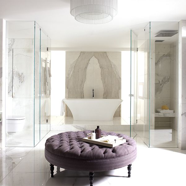 This beautiful case study from Oliver Burns Design resembles a luxurious hotel style bathroom. The marble floor and walls along with the crystal chandelier make the space opulent and the Ravello bath is the perfect centrepiece.