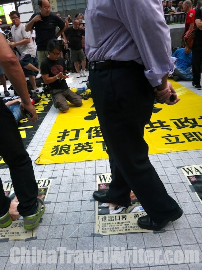 Pan-democrat supporters walk all over the pictures of pro-establishment politicians at a Hong Kong protest.  Read the full story here: http://thechinachronicle.com/hong-kong-tv-vote-delayed-aggressive-protesters-surround-legislative-council/