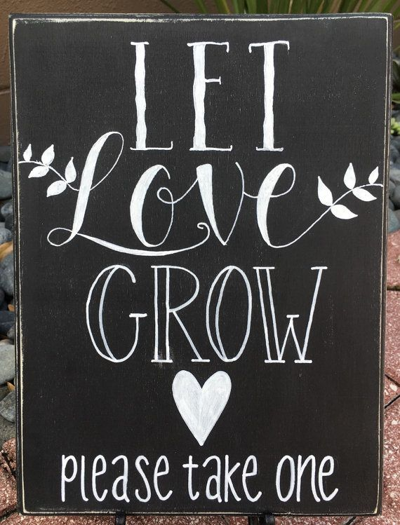 Let Love Grow! This listing is for an original, hand painted, wooden sign reading let love grow. (please take one) This sign is perfect to place next to succulent or air plant, or other living wedding favors! This wooden sign measures 9 wide by 12 tall. The wood is 15/8 thick and requires an easel to stand. Ribbon or twine can be added for hanging. This sign is painted in a classic chalkboard style and features a black background that has a slightly distressed appearance to add character…