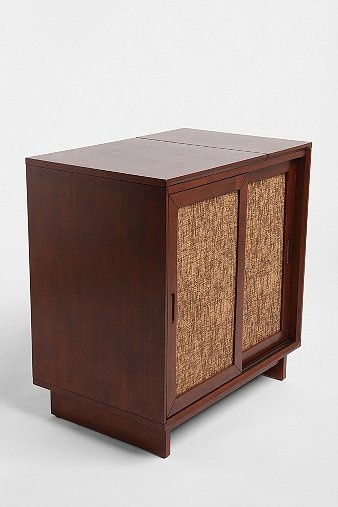 Newcomb Media Console from Urban Outfitters - could line 3 side by side for toy storage in playroom (perhaps covering panels with a more playful pattern) or as media console in living room.