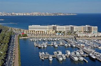 Alicante. Adore it's a city and a great beach all in one, 5 mins in a cab from the airport and great weather. Like to try and go at least every other year for a weekend, cheap flights and always stay in the Melia hotel lovely hotel, one view from bedrooms is the beach the other the marina both great. In the Summer on a Friday evening they go made with a missive firework display right on the beach. Great place