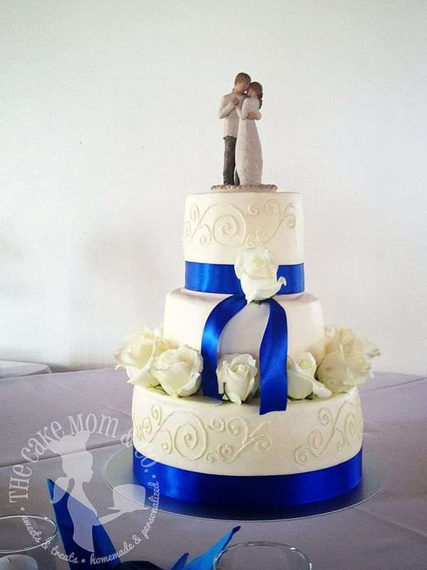 Elegant Ivory  Royal Blue Wedding Cake --- LOVE the cake topper!!!