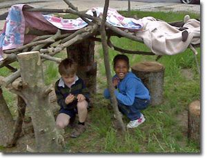Fort building with branches and fabric.