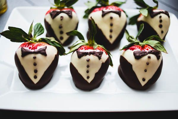 Wedding dessert ideas: tuxedo chocolate covered strawberries (SHHIVIKA CHAUHAN PHOTOGRAPHY)