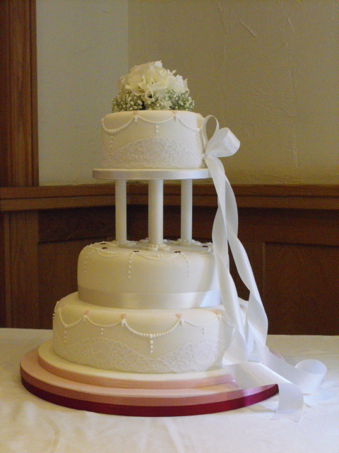 Stacked Wedding Cake With Pillars And Piping Detail