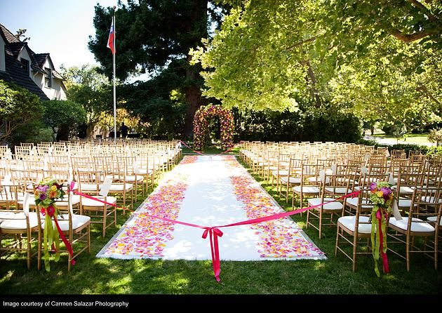 Garden wedding: the chuppah was truly a piece of eye candy, and was created with over 1,000 flowers including roses, dahlia, stock, peony, lilies, hydrangea, football mums, and scabiosa. Wedding Flowers by Visual Impact Design, Sacramento Wedding Florist | Coordination & Planning: Aimee from 2Chic Events & Design | Carmen Salazar Photography