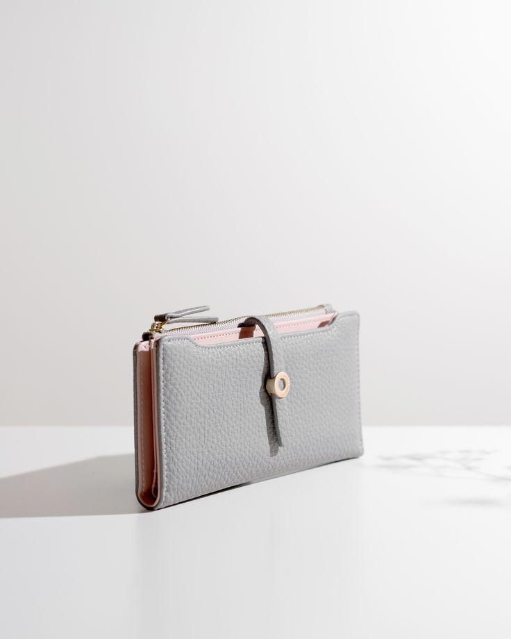 More than just your basic wallet, this simple purse is a stylish yet practical essential.