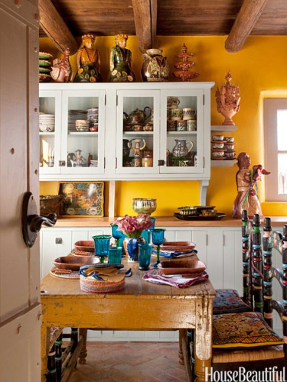 """The wooden table with mis-matched dining chairs give this kitchen that """"lived in"""" feel. I love wooden beams on the ceiling as well"""