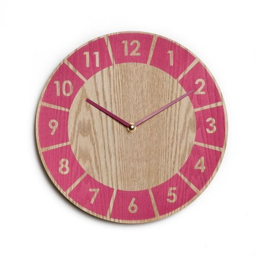In a gorgeous natural timber with a bright popof Pink, these fun Mr Wolf clocks from Adairs Kids will make a great addition to your home.