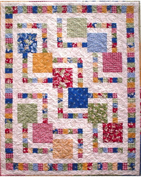 """Zoom in on your favorite large scale or novelty print fabric, and frame it with accent strips in complimentary colors. This great pattern uses 12 fat quarters, but can also be made using a single feature fabric for the larger squares. Think batik, floral, holiday, thirties, baby - the options are endless! This pattern is a wonderful way to showcase your favorite larger print fabrics that you don't want to cut up into small pieces - and it is oh, so easy to make!   The 56"""" X 72"""" quilt is the…"""